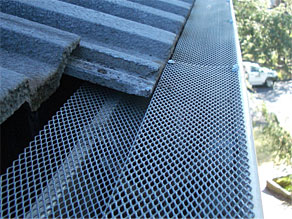 gutter guard installation on tiled roof