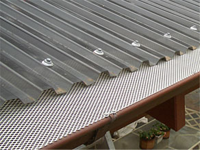 gutter guard on flat plastic roof